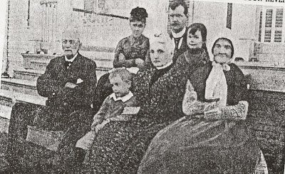 """Members of the Daniell family pose on the steps of """"Retreat,"""" home of the Freeland family. On the front row is Dr Williams, who married the widow of the builder of Windsor. Next is Smith Coffee Daniell, IV, Katherine Freeland Daniell Williams, Aunt Lizzie. On the back row are Priscilla Daniell Magruder, Thomas Freeland Daniell, his daughter Katherine Crane Daniell."""