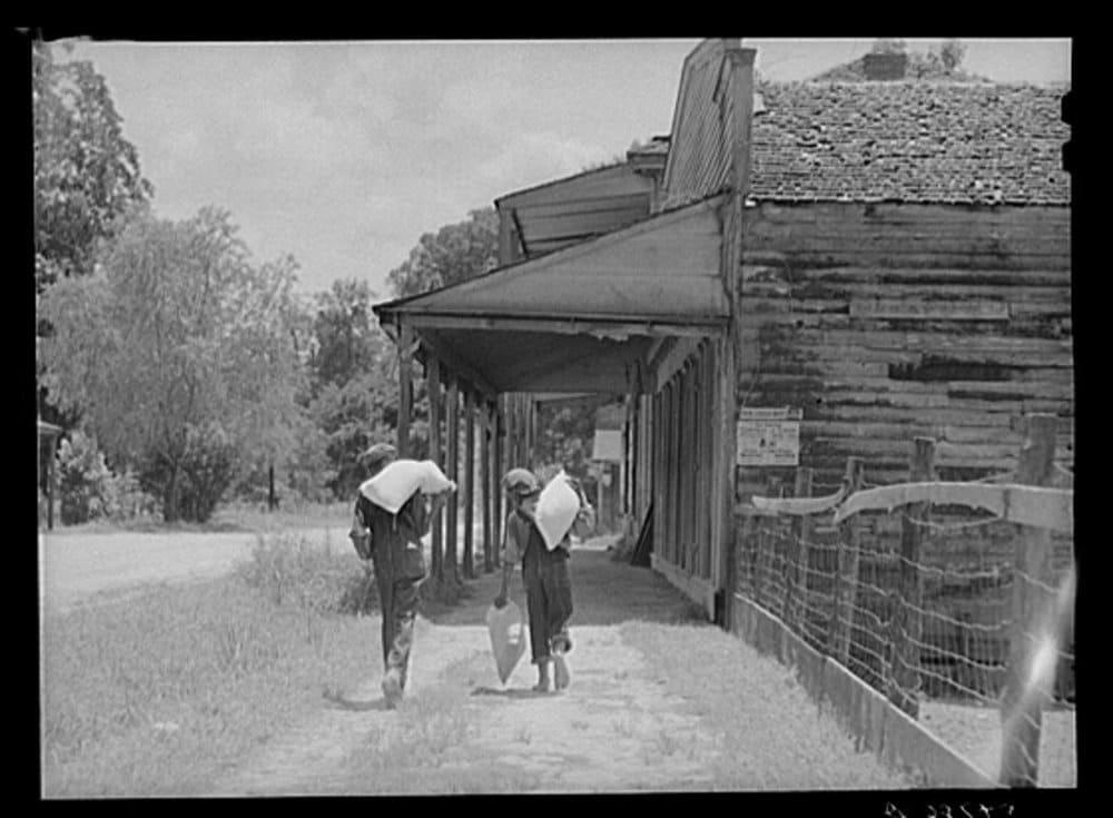 ms rodney orig martha mckay kids with grain sacks walking.jpg
