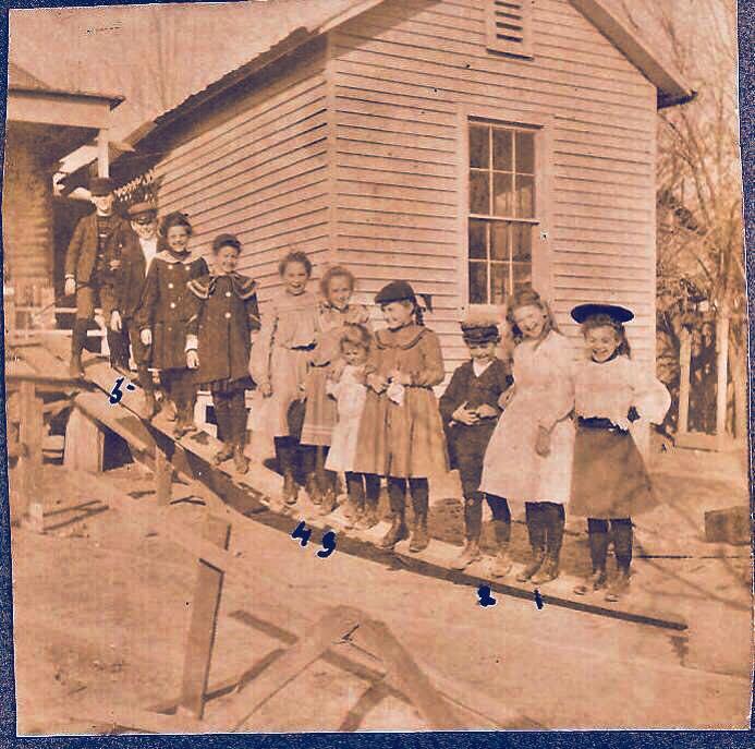 ms rodney orig photo kids on slide angel puckett holland.jpg